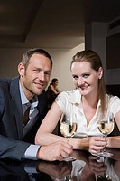 Couple drinking wine in a bar