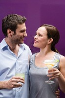 Couple holding cocktails