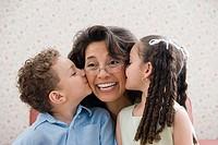 Kids kissing grandmother
