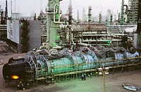 Workers around separation in oil refinery. USA