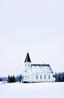 Old fashioned steeple church in winter