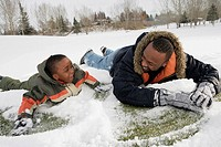 Father and son playing on snow
