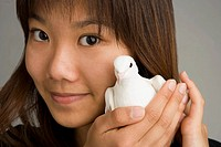 A woman holding a dove