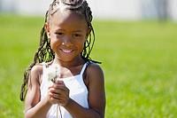 Girl holding dandelions