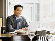 Asian businessman working at restaurant