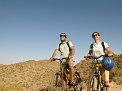 Hispanic couple on scenic bicycle ride