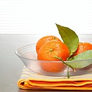 Tangerines in glass bowl, close-up