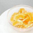Slices of tangerines in glass bowl, close-up