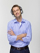 Young man wearing headphones listening to music, portrait