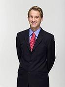 Young businessman, smiling, portrait