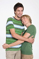 Front view portrait of young couple with arms around each other