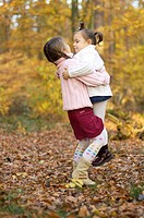 Children, girl, two, autumn, forest, plays, embrace, hoists, friends, 3-8 years, siblings, sisters, sister, old-age-difference, love, affection, holdi...