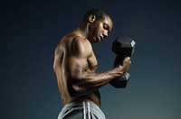 African American man lifting weights