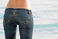 Rear view of woman wearing jeans