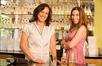Hispanic female sales clerks at perfume store