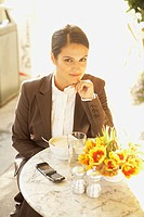 Hispanic businesswoman at cafe
