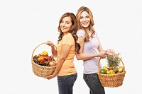 Hispanic mother and adult daughter with baskets of food