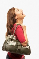 Hispanic woman with purse full of money