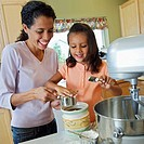 Mother and Daughter Preparing Batter