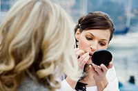 Wedding bride applying make-up