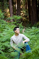 Asian man in woods