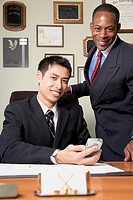 Multi-ethnic businessmen behind desk