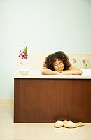 African American woman in bathtub