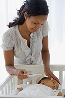 African American mother checking baby's temperature (thumbnail)