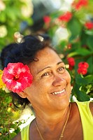 French Polynesia, Tahiti, Maupiti, local women with hibiscus flower