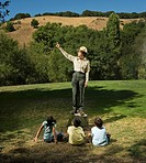 Multi-ethnic children listening to Park Ranger