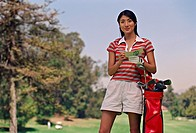Asian woman on golf course