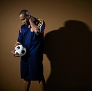 African American man holding soccer ball