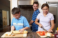 Multi-ethnic family preparing food