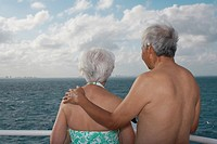 Senior Asian couple looking out over water