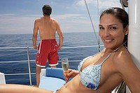 Multi-ethnic couple on sailboat