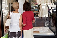 Senior African American women window shopping