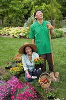 Senior Asian couple gardening