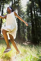 African girl running in woods
