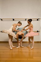 Hispanic female ballet dancers in studio
