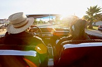 Hispanic couple driving convertible (thumbnail)