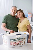 African American couple next to folded laundry