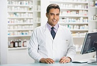 Hispanic male pharmacist behind counter