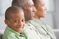 African American boy next to family