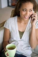 African American woman talking on telephone (thumbnail)