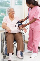 Nurse taking senior woman's blood pressure (thumbnail)