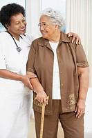 Doctor helping senior African American woman walk (thumbnail)