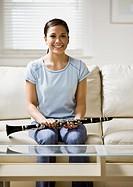 Asian girl holding clarinet