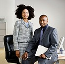 African American businesspeople in front of desk
