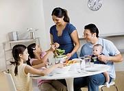 Multi-ethnic family at dinner table
