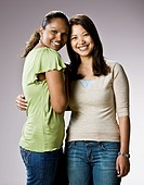Multi-ethnic women hugging